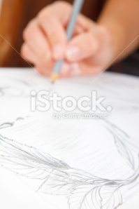 stock-photo-21225388-young-woman-s-hand-sketching